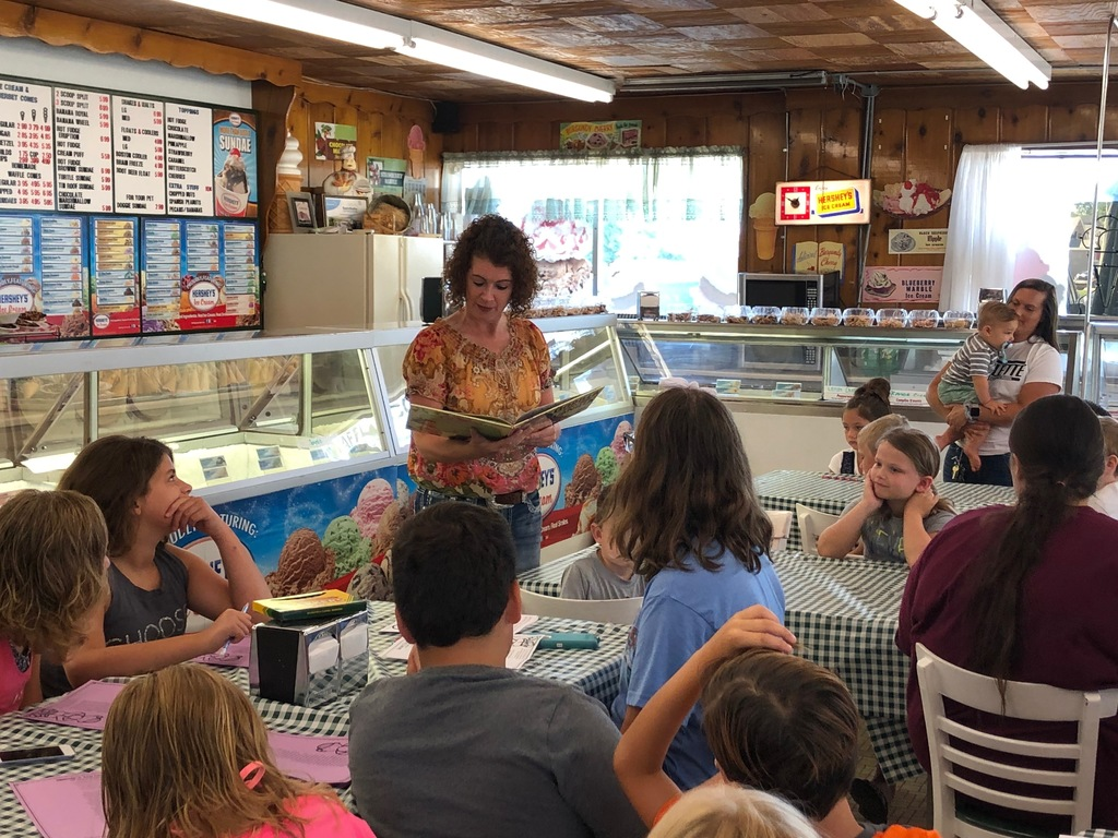 Mrs. Wood reading at Luv More Ice Cream